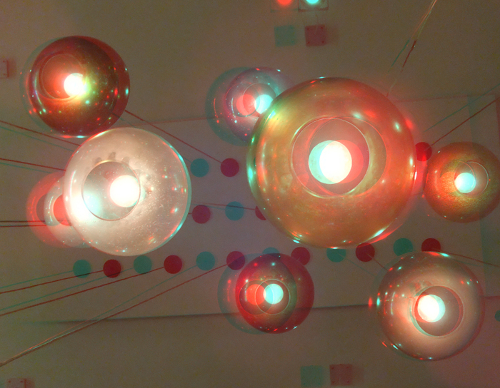 3D photos of hanging lights above the dining area at Tom's Urban 24 diner in Denver.